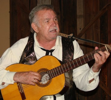 """Sandy Gibbons croons a few tunes during his stint as Honest John in """"Murder at the High Noon Saloon"""" at Rawhide in 2011. (Photo credit unknown)"""