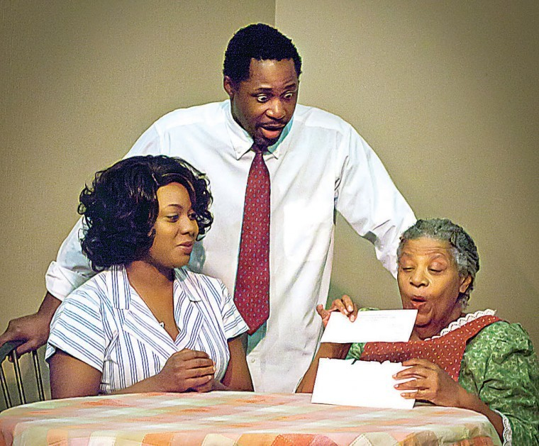 """Chanel Bragg (Ruth Younger), left, DeJean Brown (Walter Lee Younger) and Joyce Gittoes (Lena Younger) share a scene in a """"Raisin in the Sun,"""" at Desert Stages Theatre in Scottsdale. (Photo Credit Unknown)"""