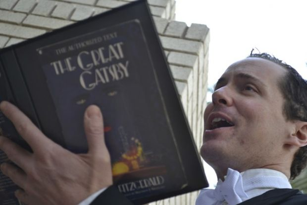"Ian Christiansen reads ""The Great Gatsby"" aloud at Tempe Marketplace. (Photo courtesy of Arizona Theatre Company)"