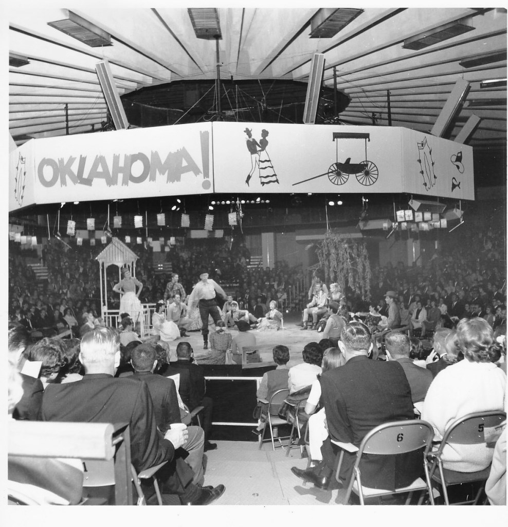 "In 1965, John Raitt starred in the Star Theatre's production of ""Oklahoma!"", presented, as were all the shows, in the round."