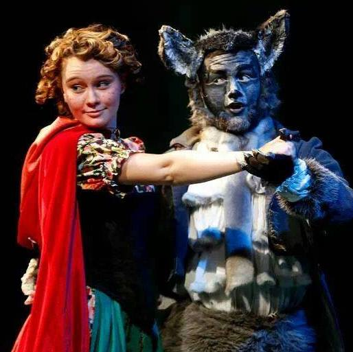 Grand Canyon College. 2014. Into the Woods. Rachel Callahan as Little Red Riding Hood and Cole Brackney as the Wolf. Photo credit not provided.