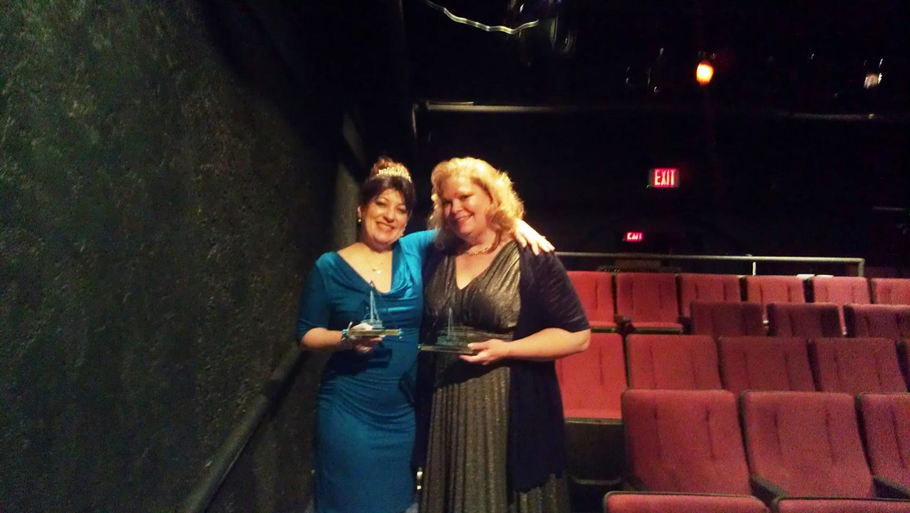Lizz Reeves Fidler and Tanya Schoenwolf show off their 20014 Prizm Awards from Fountain Hills Theatre. (Photo credit unknown)