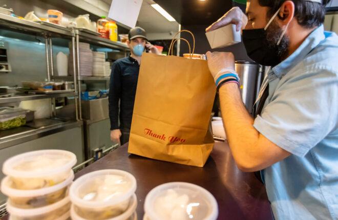 restaurant worker preparing takeout