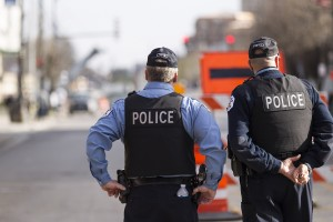 Chicago Police Officers close off and secure a street ahead of a planned protest march. 4/15/2015