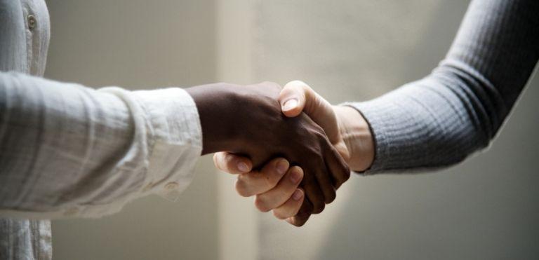 shaking hands business law fargo