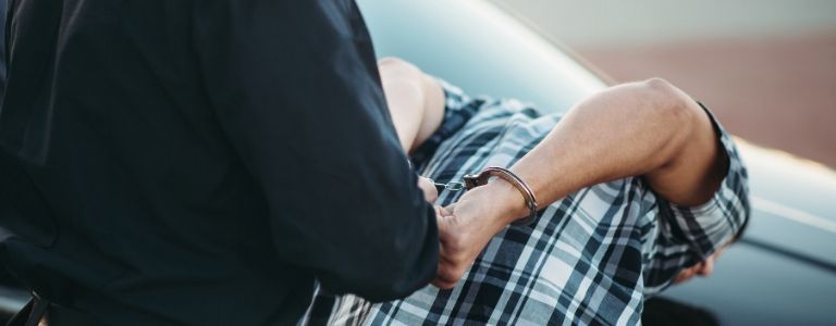 man under arrest criminal law fargo