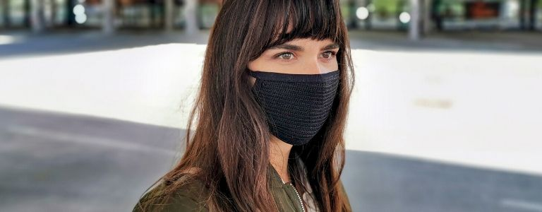 woman in covid mask business law fargo
