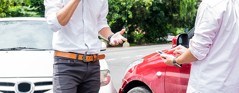 men standing next to car personal injury fargo