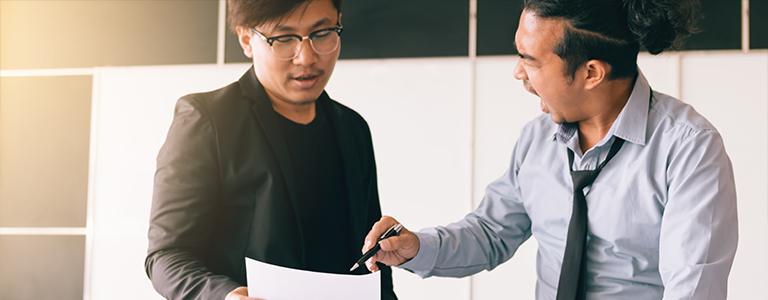 two men looking at paper estate planning fargo