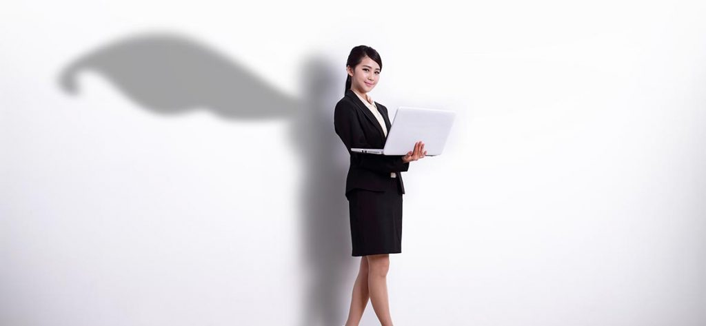 Superhero business woman using laptop computer with white wall background great for your design or text asian