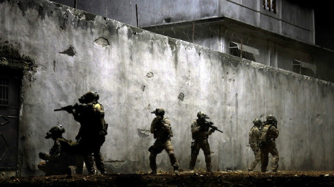 No Merchandising. Editorial Use Only. No Book Cover UsageIn the darkest hour of the night, elite Navy Seals raid Osama Bin Laden's compound Zero Dark Thirty - 2012  (Rex Features via AP Images)