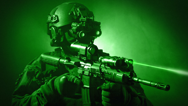 Special operations forces soldier equipped with night vision and an automatic weapon.