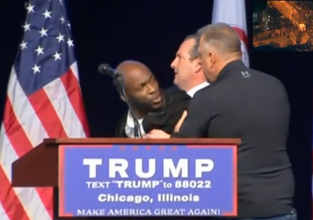 Trump-Protest-Chicago-Man-on-Stage-e1457743515437