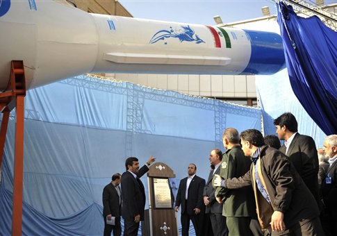 Iranian President Mahmoud Ahmadinejad, center, gestures towards a model of Iran's new domestically-built light booster rocket, named Simorgh, in Tehran, Iran, Wednesday, Feb. 3, 2010. Iranian President Mahmoud Ahmadinejad has unveiled a domestically-built satellite booster rocket, part of an ambitious space program that has worried Western powers because they fear the same technology used to launch satellites could also deliver warheads. (AP Photo)