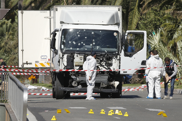 Investigators continue to work at the scene near the heavy truck that ran into a crowd at high speed killing scores who were celebrating the Bastille Day July 14 national holiday on the Promenade des Anglais in Nice, France, July 15, 2016. REUTERS/Eric Gaillard - RTSI2GB