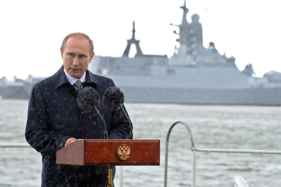 Russian President Vladimir Putin delivers a speech under the rain during celebrations for Navy Day in Baltiysk in the Kaliningrad region on July 26, 2015. AFP PHOTO / RIA NOVOSTI / POOL / MIKHAIL KLIMENTYEV (Photo credit should read MIKHAIL KLIMENTYEV/AFP/Getty Images)