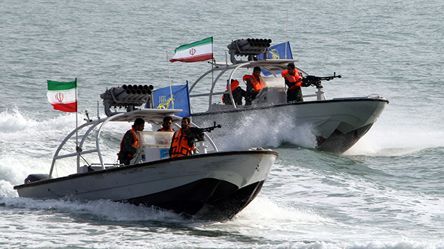 Iranian Revolutionary Guards drive speedboats during a ceremony to commemorate the 24th anniversary of the downing of Iran Air flight 655 by the US navy, at the port of Bandar Abbas on July 2, 2012. The plane was shot down by mistake over the Gulf by the US navy's guided missile cruiser, USS Vincennes, during confrontation with Iranian speedboats on July 3, 1988, killing 290 civilian passengers and crew members. AFP PHOTO/ATTA KENARE (Photo credit should read ATTA KENARE/AFP/GettyImages)