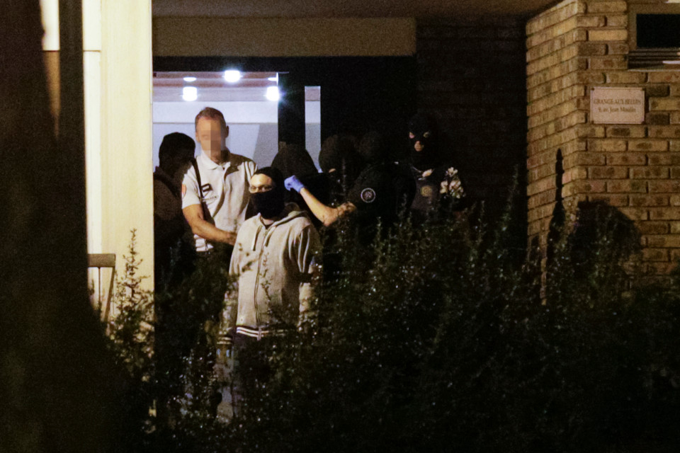 A woman (C hood) is taken out of a building in Boussy-Saint-Antoine south of Paris on September 8, 2016 where female suspects, said to have been planning new acts of violence, were arrested. French police investigating the discovery a car containing six gas cylinders in Paris, on Thursday arrested three female suspects said to have been planning new acts of violence, shooting one of them in the process. / AFP PHOTO / GEOFFROY VAN DER HASSELTGEOFFROY VAN DER HASSELT/AFP/Getty Images