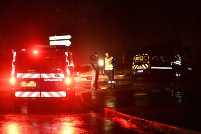 """Gendarmes stand guard on a road near a retirement home for monks in Montferrier-sur-Lez, southern France, early on November 25, 2016, after an armed man bursted in the home killing a woman with a knife. Armed police were hunting the man inside the home, which is home to around 70 men and women who have served as missionaries in Africa. Authorities said it was a """"criminal act"""". / AFP / PASCAL GUYOT (Photo credit should read PASCAL GUYOT/AFP/Getty Images)"""