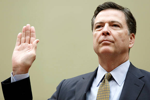 """Director James Comey is sworn in before testifying at a House Oversight and Government Reform Committee on the """"Oversight of the State Department"""" in Washington U.S. July 7, 2016. REUTERS/Gary Cameron - RTX2K5VV"""