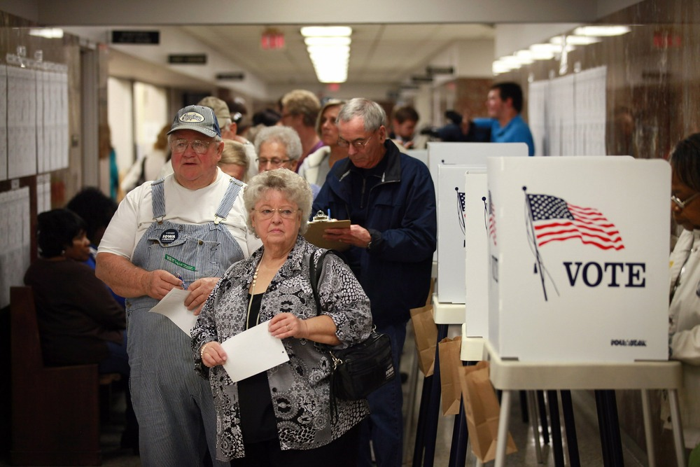 WATERLOO, IA - SEPTEMBER 27: Residents wait in line to pick up a ballot during early voting at the Black Hawk County Courthouse on September 27, 2012 in Waterloo, Iowa. Early voting starts today in Iowa where in the 2008 election 36 percent of voters cast an early ballot. (Photo by Scott Olson/Getty Images)