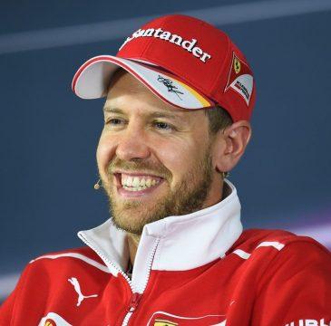 Sebastian Vettel demonstra muita satisfação com o desempenho da Ferrari este ano. Foto: Ferrari