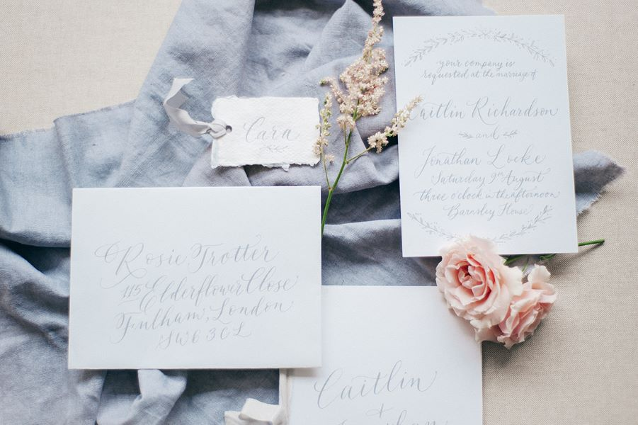 grey and white calligraphy wedding stationery