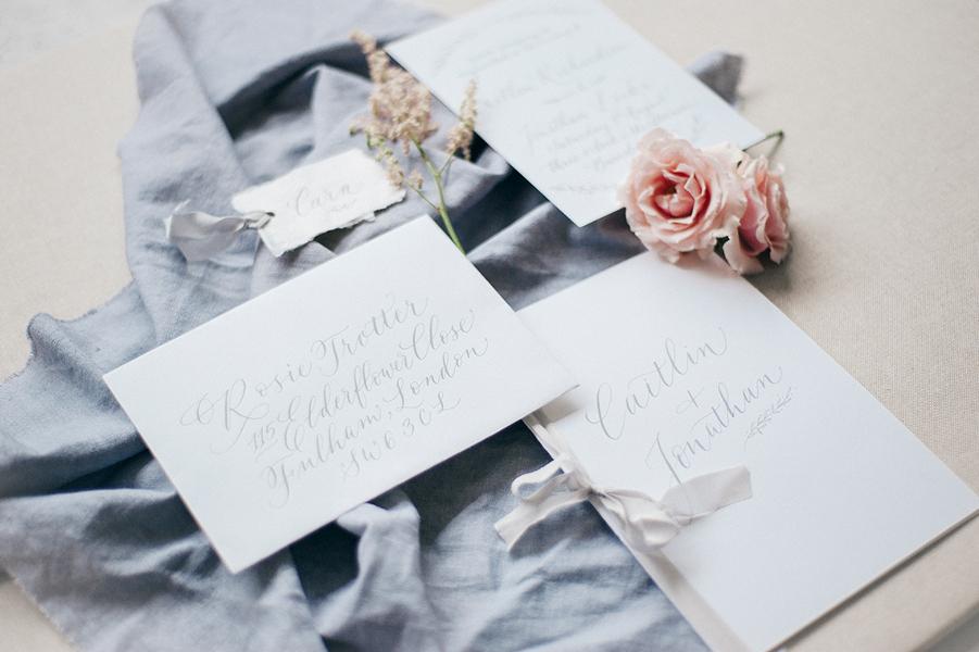 Grey calligraphy wedding invitation suite