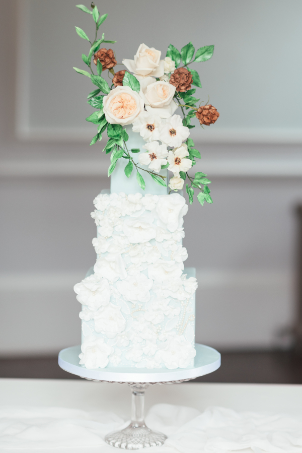4 tier wedding cake with ruffle texture and fresh flowers