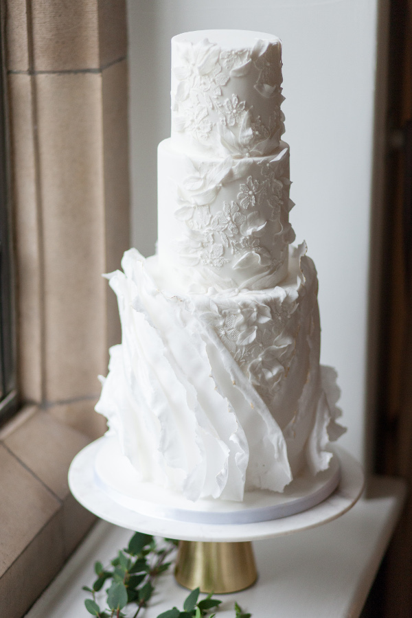 3 tier wedding cake with large ruffle detail in white
