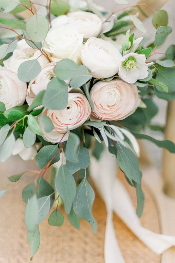 Unstructured wedding bouquet with peonies and roses