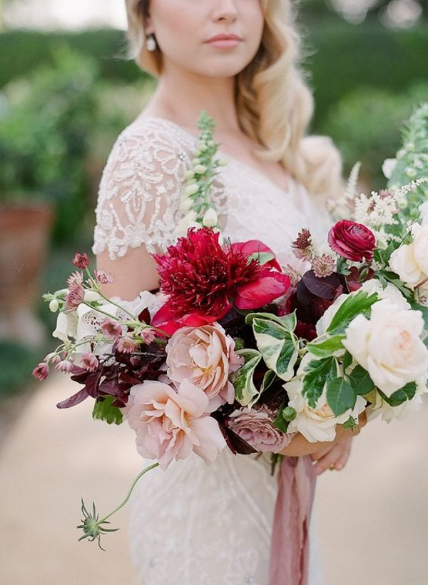Bride bouquet featuring spring peonies and foxglove, as well as lush summer garden roses