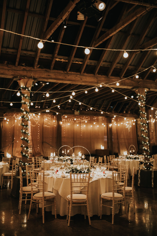 Festooned fairy lights wrapped around pillars and suspended from the ceiling