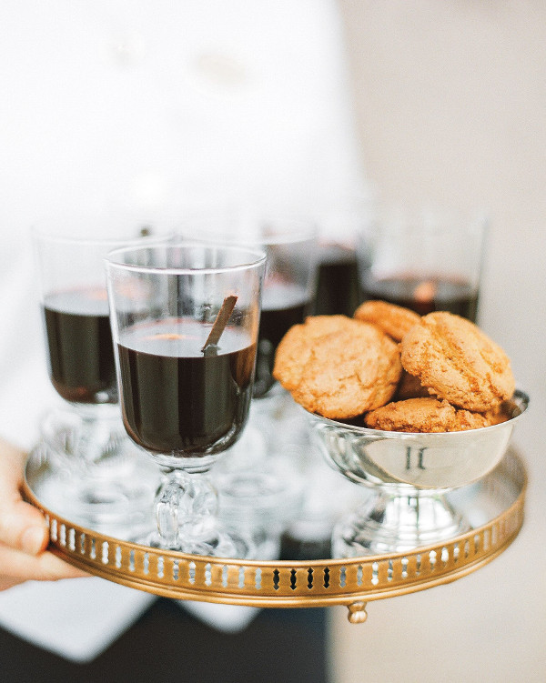 Hot chocolate and biscuits served on a gold rimmed tray