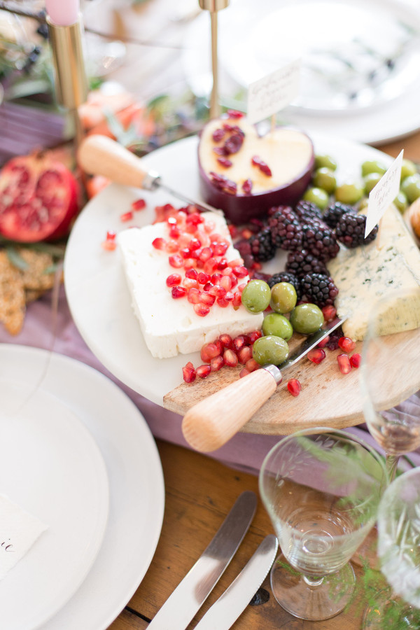 Grazing table with cheeses and fruits