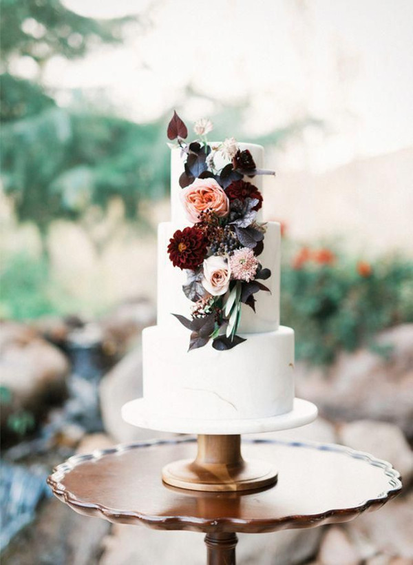 3 tier wedding cake with blush and burgundy flowers