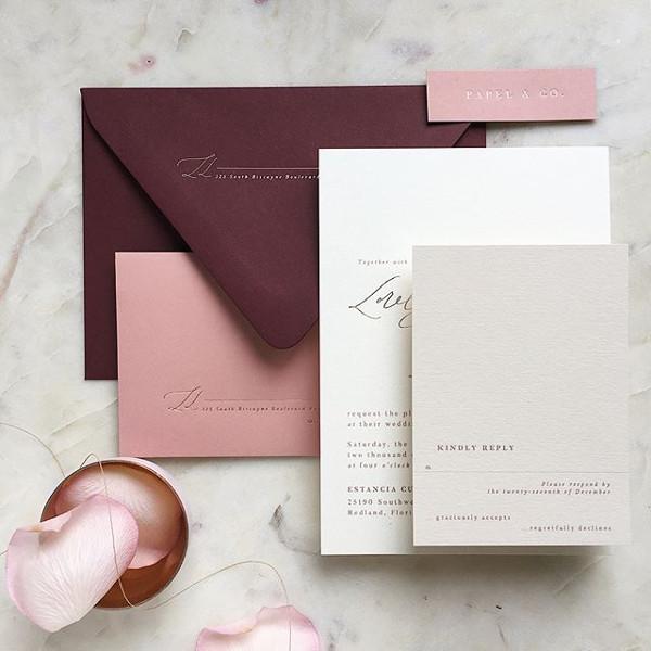 Pink and burgundy wedding stationery