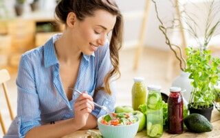 happy-healthy-woman-eating-folic-acid-rich-salad
