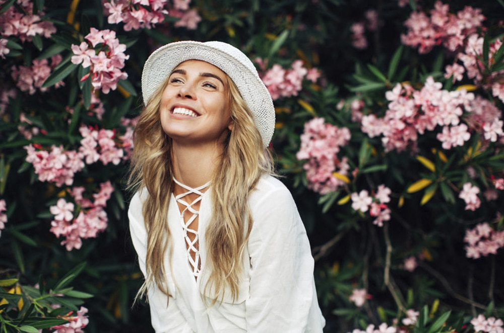 Happy Woman With Flowers Background