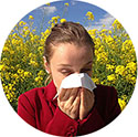Photo of person affected by allergic symptoms of seasonal pollen