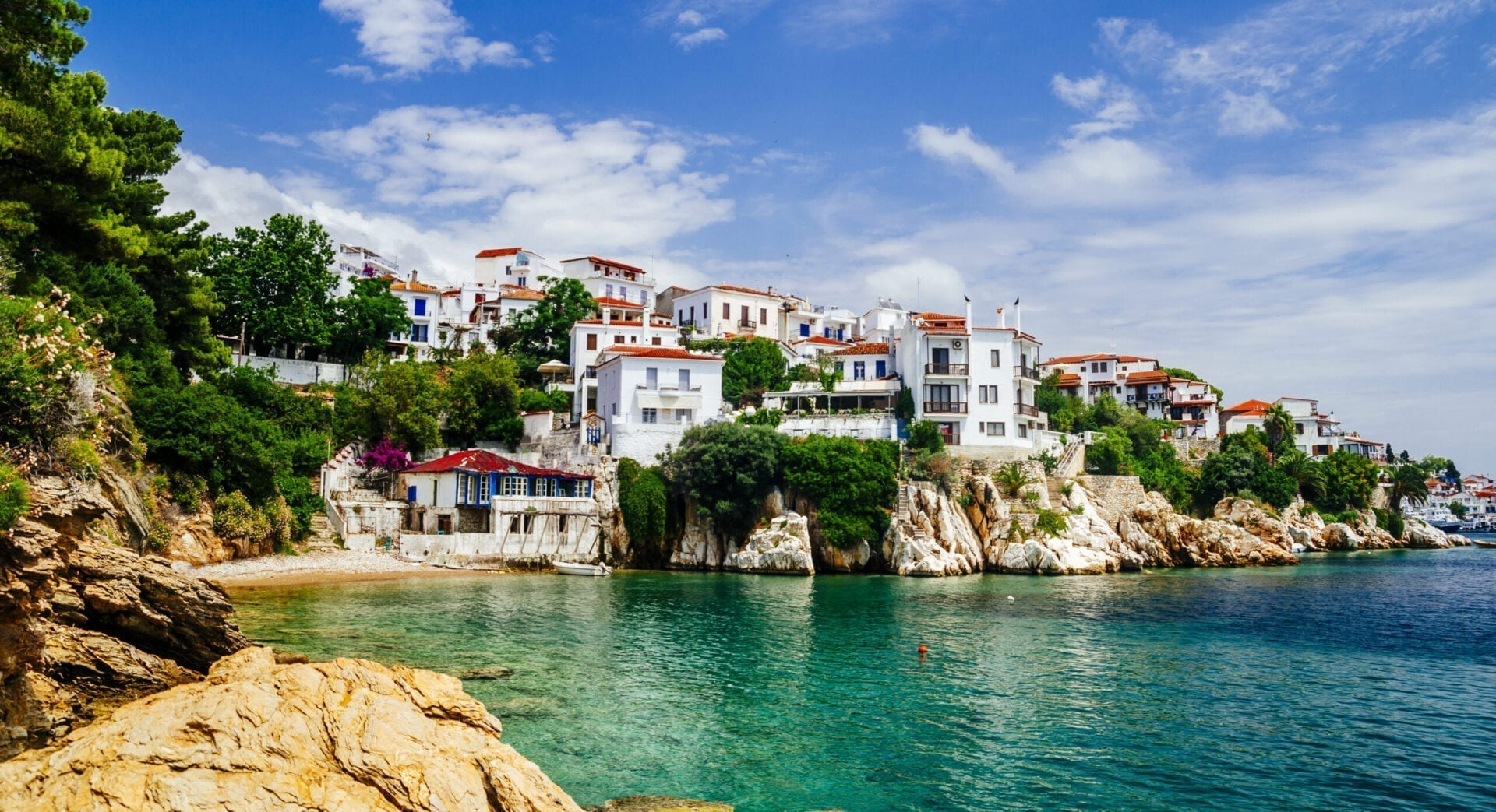 Old town view of Skiathos island, Sporades, Greece. Greek traditional architecture and aegean sea. Popular summer holiday destination scene.