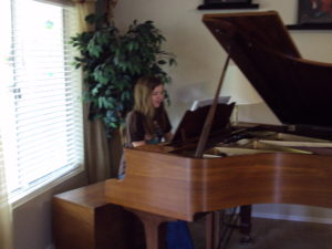 Daughter-playing-grand-piano
