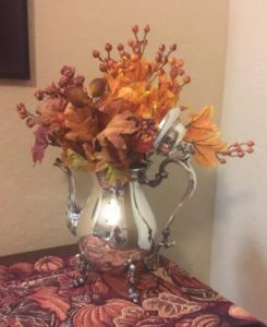 Silver teapot with autumn flowers