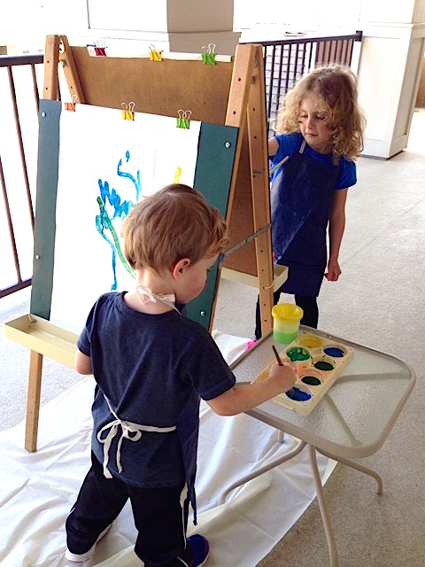 Little Ones concentrating on their painting | urbnspice.com