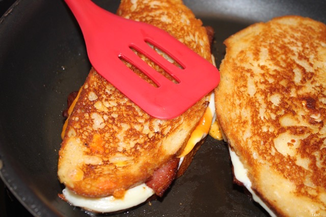 Pressing the Grilled Cheese with a spatula every time your flip it ensures a golden crust | urbnspice.com