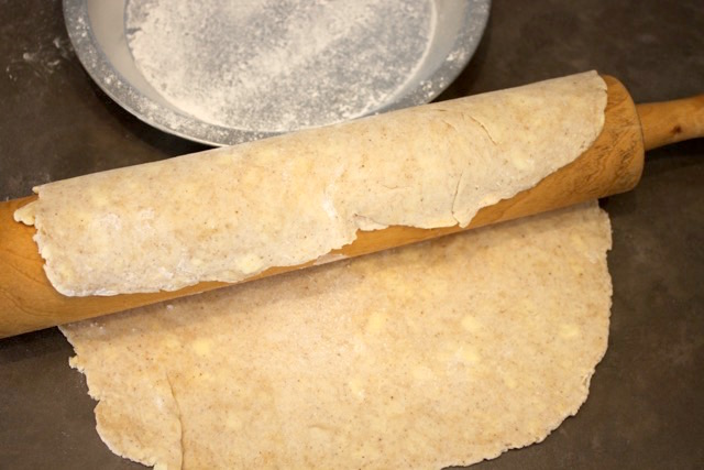 Fold the pie dough over the rolling pin | urbnspice.com