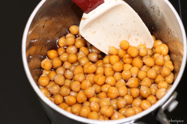 Coating the chick peas with spices and seasonings | urbnspice.com