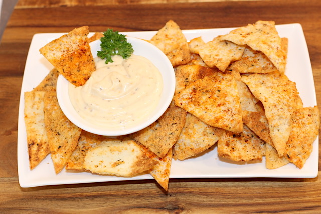 Roasted Garlic Dressing as a dip with Parmesan Pita Crisps | urbnspice.com