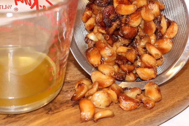 Straining the roasted garlic cloves | urbnspice.com