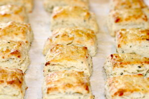 A tray of baked Asiago Cheese and Chive Scones   urbnspice.com